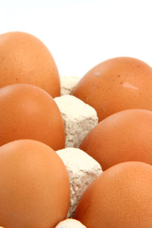 six eggs in cartonbox isolated on white background with copy space photo