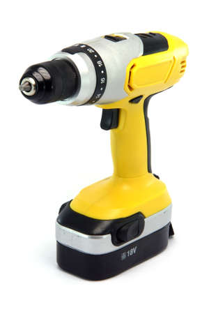 yellow rechargeable drill isolated on white background industrial tools