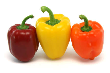 three color peppers from above isolated on white background food and vegetables concepts photo