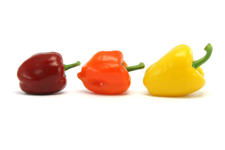 different size and color peppers isolated on white background food and vegetables concepts photo