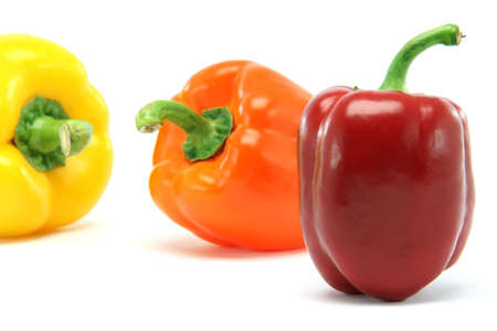 clor peppers focus on red one closeup isolated on white background food and vegetables concepts photo