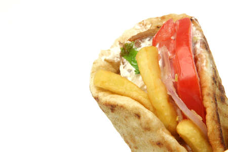 junkfood: traditional greek food gyros kebap deatil with copy space isolated on white background