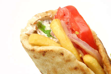 traditional greek food gyros kebap detail isolated on white background photo