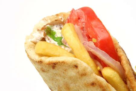 pita: traditional greek food gyros kebap detail isolated on white background