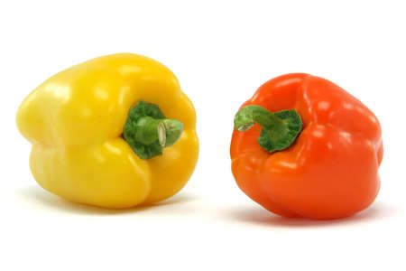 yellow and orange color  peppe closeup isolated on white background food and vegetables concepts photo