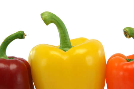detail from three color peppers isolated on white background food and vegetables concepts photo
