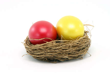 twing: red and yellow easter egg in a nest isolated on white background seasonal Stock Photo
