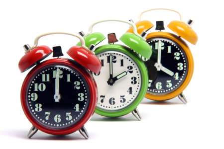 three classic small alarm clocks isolated on white background Stock Photo - 2983490
