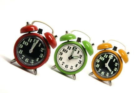 three classic small alarm clocks isolated on white background Stock Photo - 2983487