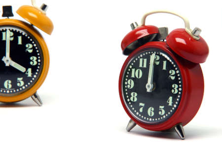 red and orange color alarm clock at twelve oclock isolated on white background Stock Photo - 2983488