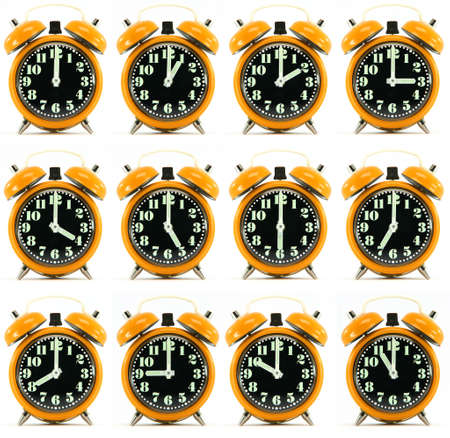 classic small alarm clock twelve hours isolated on white background multiple image orarnge color Stock Photo - 3041132