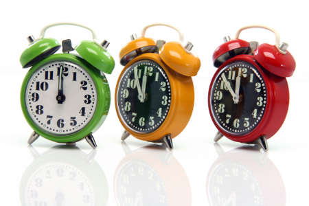 timing red yellow and green alarm clock untill twelve oclock closeup with nice reflection Stock Photo - 3041125
