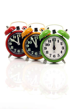 timing red yellow and green alarm clock untill twelve oclock closeup with nice  reflection vertical Stock Photo - 3041123