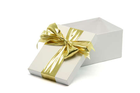 open white gift box with golden ribbon isolated on white
