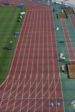 hurdles: stadium houndred meters sports track lanes and long jump detail from athens greece sports competition stadium