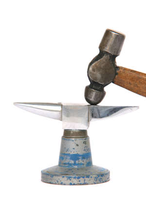 inox: tiny inox anvil and small hammer detail isolated on white background