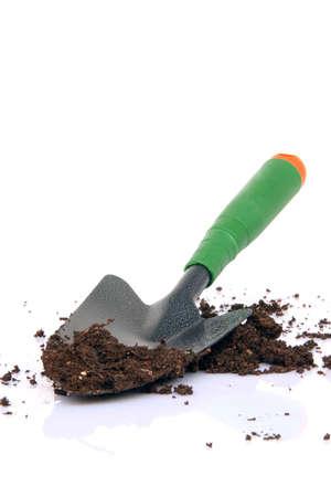 garden tools shovel and soil on white background