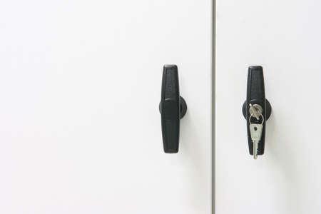 white metallic closet detail black handles with keys Stock Photo - 3477988