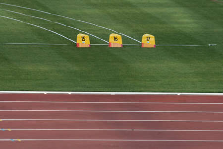 detail from empty athletics race track and field photo