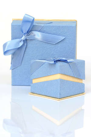 two cyan gift boxes with reflection isolated on white Foto de archivo