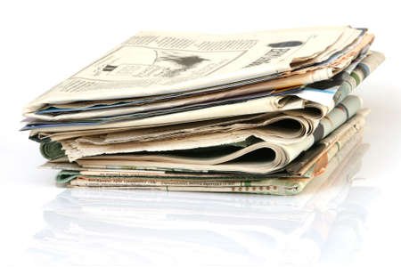 media concepts stack of newspapers with reflection isolated on white background