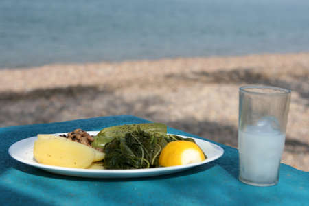 boiled mixed vegetables salad with glass of ouzo Stock Photo