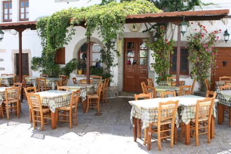 taverns: traditional greek tavern reastaurant tables and chairs at patmos island dodecanese greece