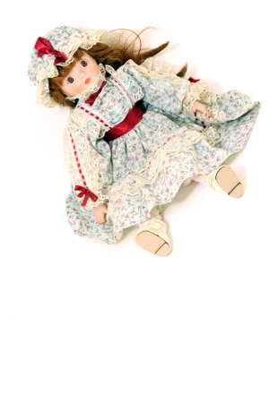 little girl beautiful antique porcelain doll old fashioned on white background Foto de archivo