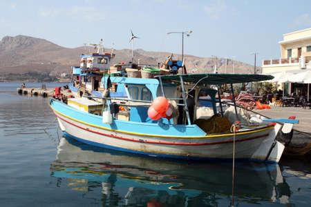 fishingnet: fishing boats moored at leros island greece Stock Photo