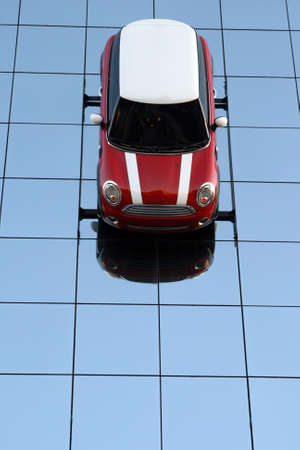 cooper: red and white car on glass wall reflected