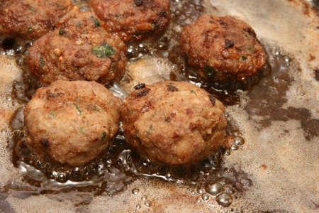 meatballs frying in hot olive oil greek recipie  Foto de archivo