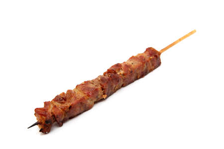 pork kebap on wooden stick grilled isolated on white background Foto de archivo
