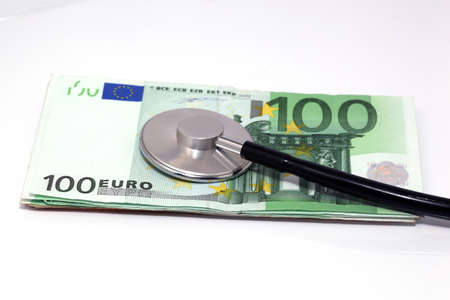 expensive health treatment stethoscope hundred euro banknotes photo