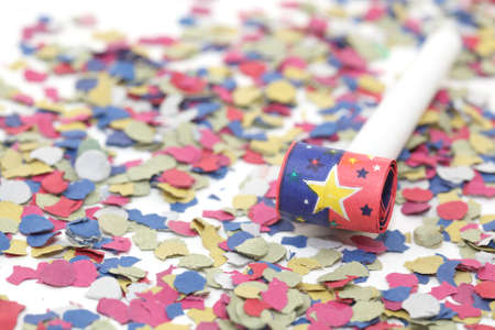 celebration and party one blowers on paper confetti photo