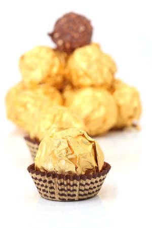 closeup gold wraped chocolate sphere dessert photo
