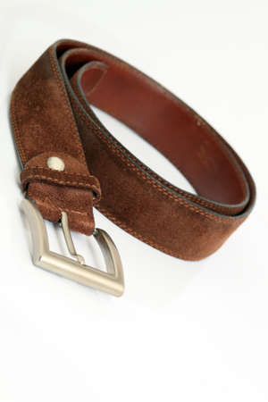 stitched: brown leather belt siolated on white background with copy space apparel and accessories Stock Photo