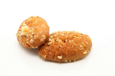 two traditional Greek Christmas sweets called melomakarona or phoenikia. A honey-dipped cookie, with wallnuts on top photo