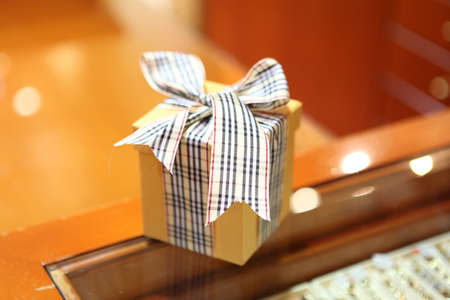 robbon: gift box on store window with soft blur background Stock Photo