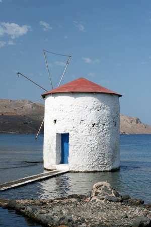 dodecanese: floating water mill in the sea Leros island dodecanese greece