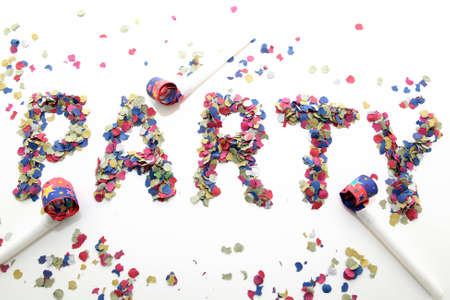 blowers: party word with confetti and three blowers on white background