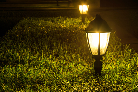 garden lawn: Yellow light in the park at night Stock Photo