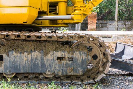 Close-up Wheel loaders contaminated soil