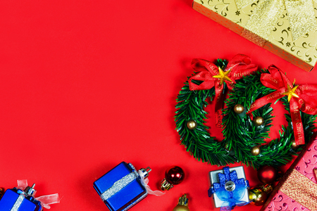 Merry colors gift boxes placed christmas on red background