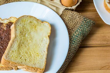 bread and butter: Breakfast bread butter and chocolate on a wooden table Stock Photo