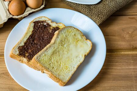 shabbat: Breakfast bread butter and chocolate on a wooden table Stock Photo