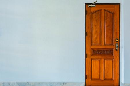 door knob: wood Door closed and Cement background