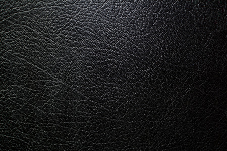 black leather texture and background. selection focus lowkey