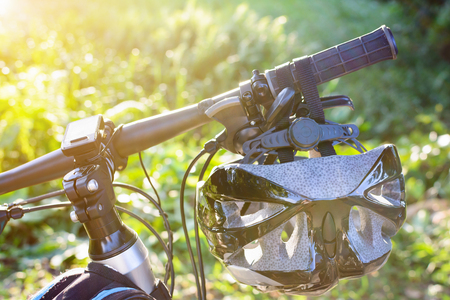 Bike helmet and bike on the street and evening sun.  smooth soft focus Stock Photo