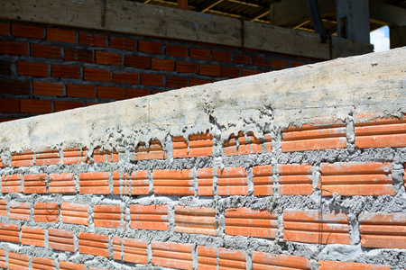 putty knives: Construction wall Building with brick and cement at daytime