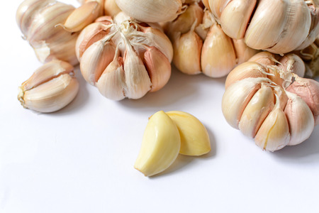 spiciness: Garlic health food has a pungent odor on the white background